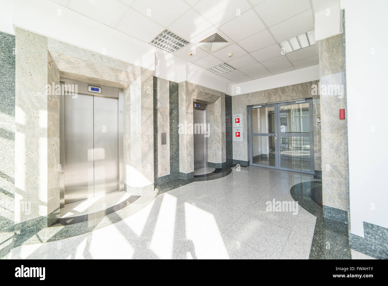 The lift lobby - two closed elevator and door - Stock Image