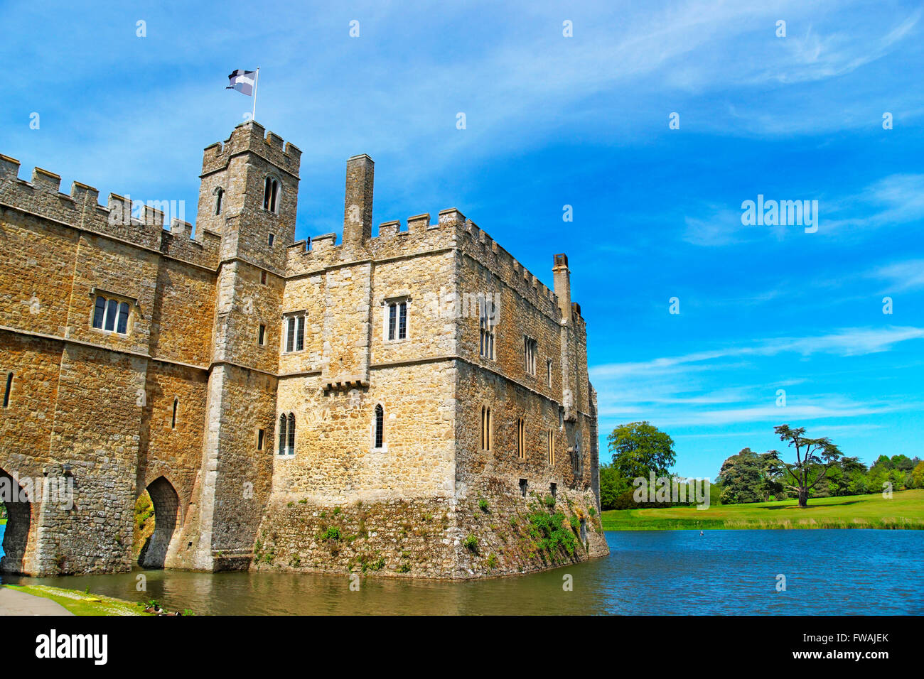 Leeds Castle in the island on the lake in Kent in England. The castle was built in the twelfth century as a king - Stock Image
