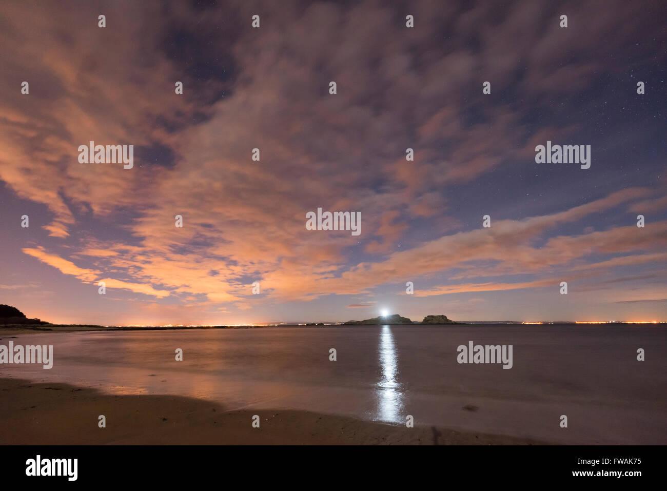Fidra island and night sky over the Firth of Forth estuary, East Lothian, Scotland - Stock Image