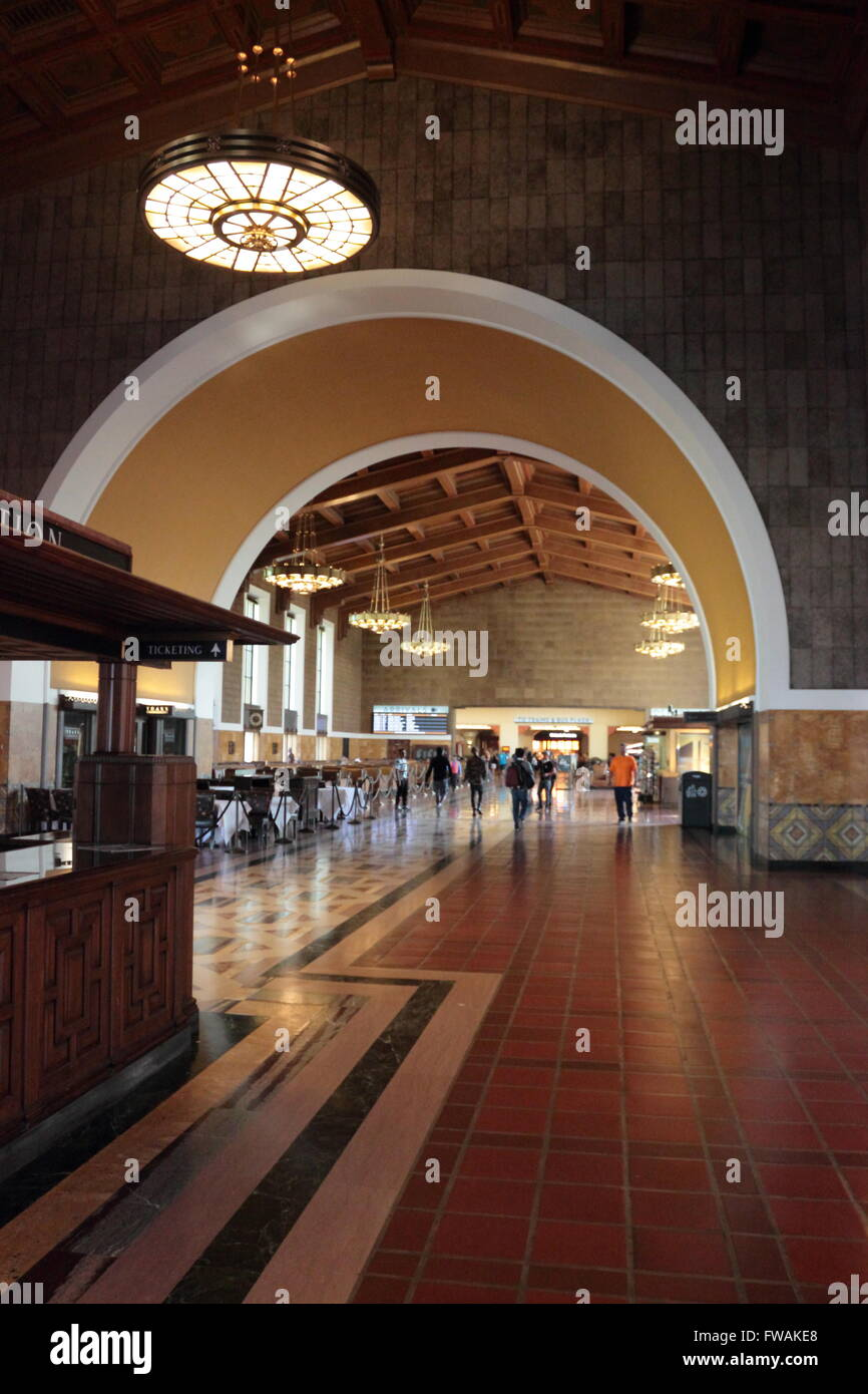 Interior of Union Station, Los Angeles, California, USA showing the information booth and commuters milling in the Stock Photo