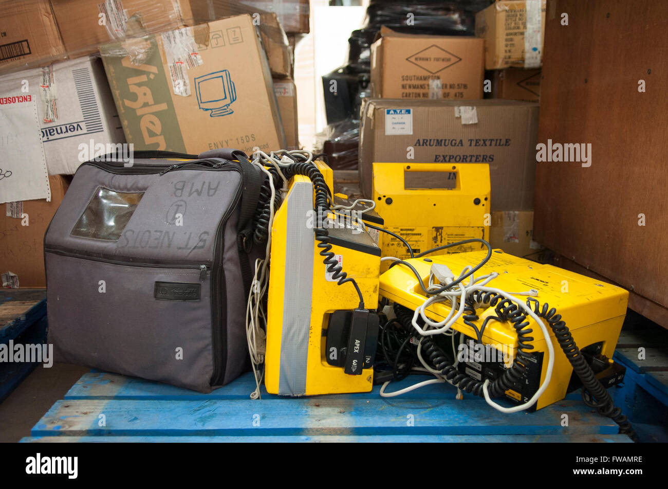 Much Hoole, Preston, Lancashire. Used heart defibrillators wait at the International Aid Trust warehouse to be donated - Stock Image