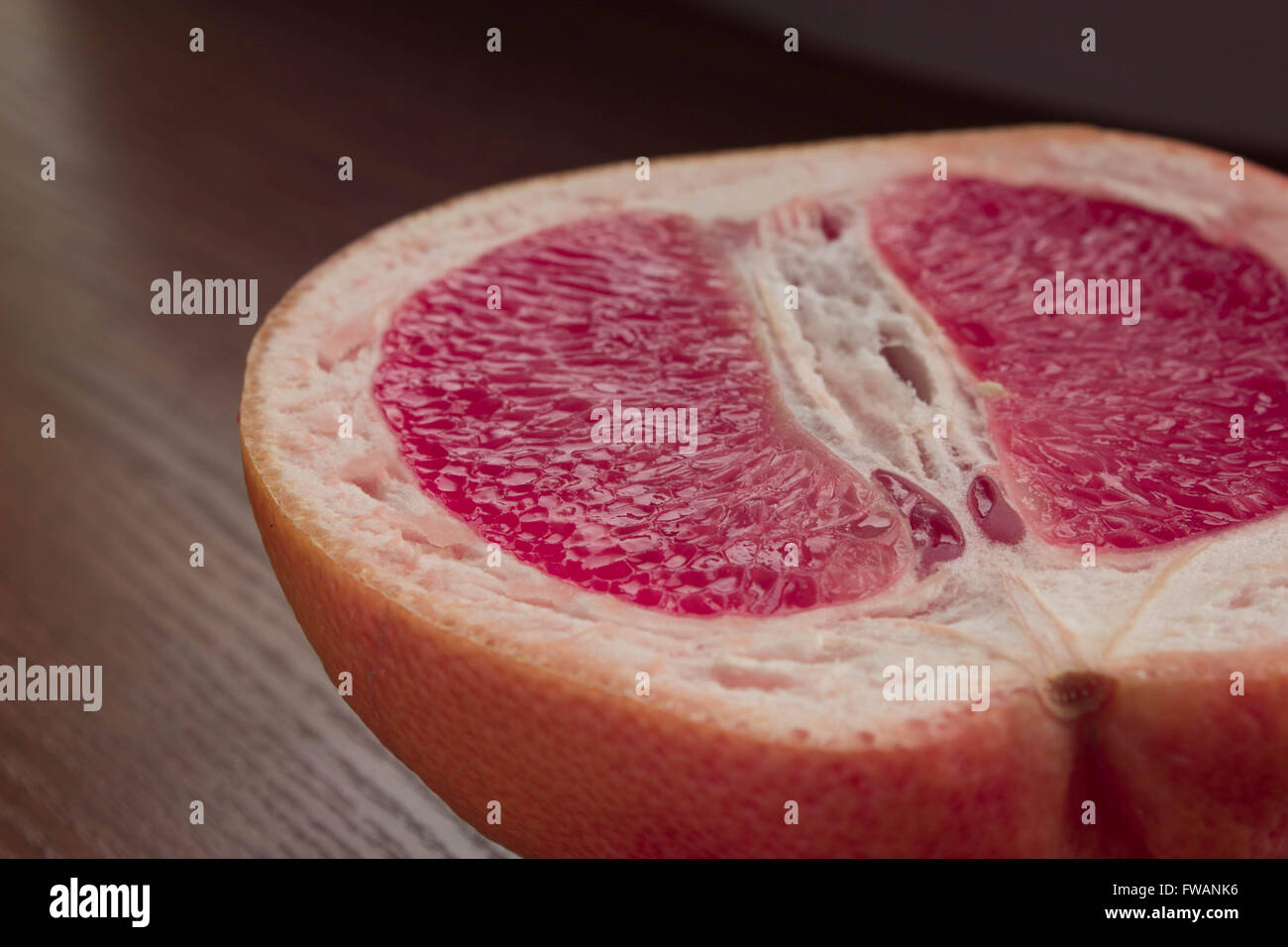 fresh juicy grapefruit on a wooden table - Stock Image
