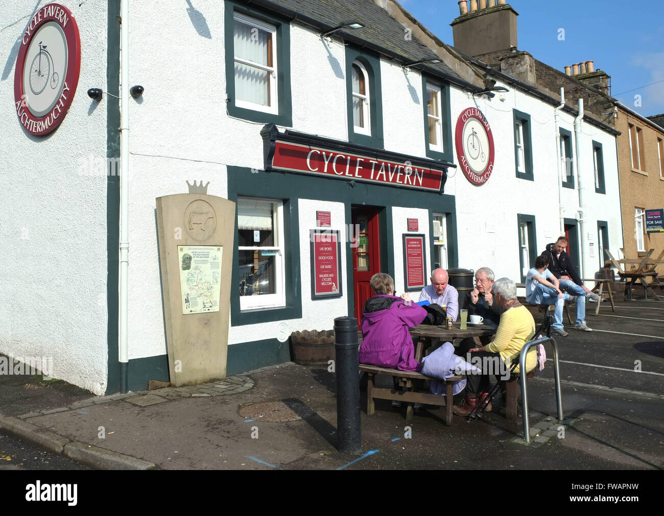 Customers enjoy a refreshment outside the Cycle Tavern in Auchtermuchty, Fife, Scotland, - Stock Image
