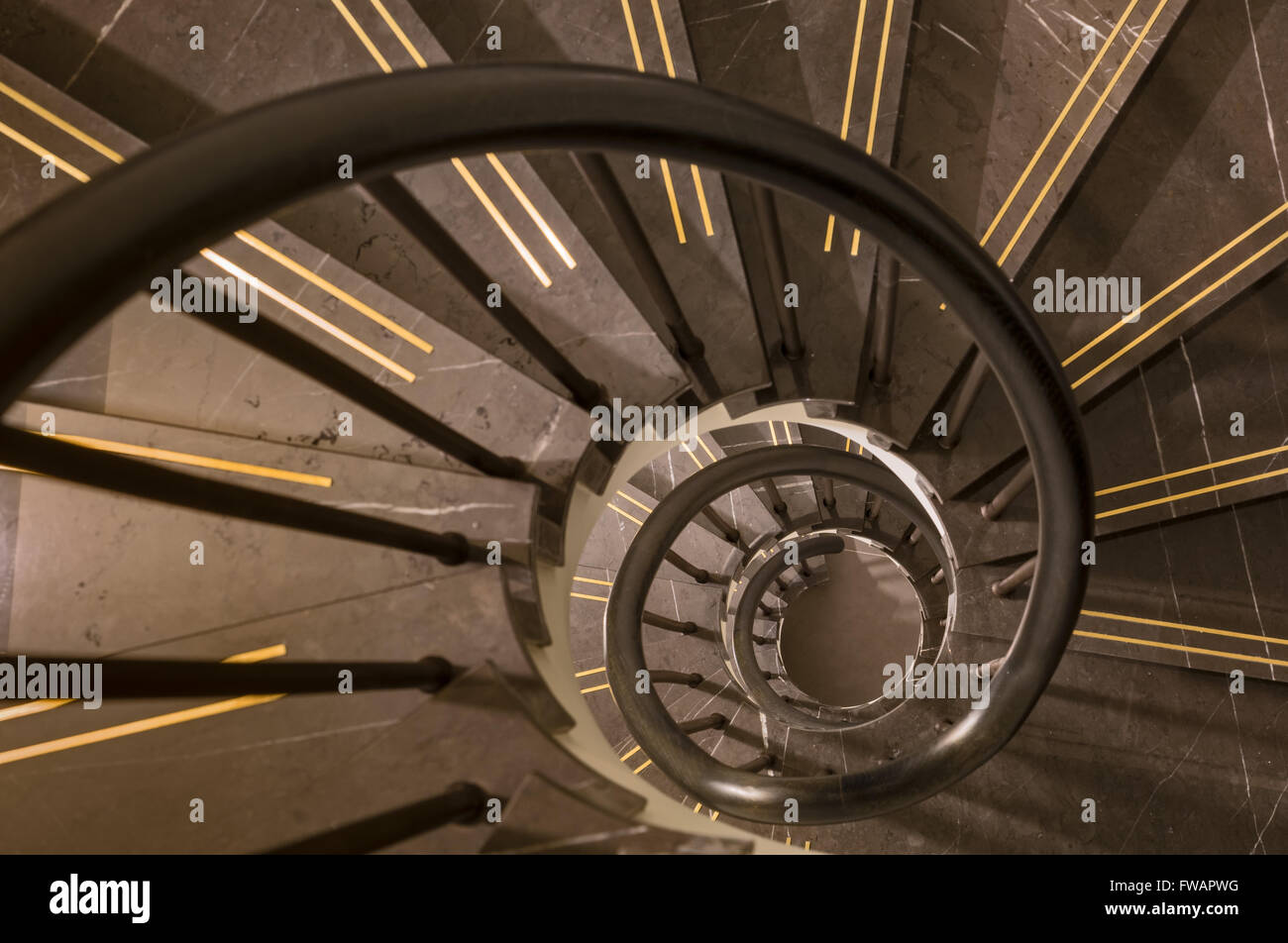 Spiral staircase in a London apartment - Stock Image