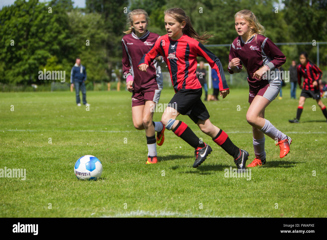 Girls playing football in Holland - Stock Image