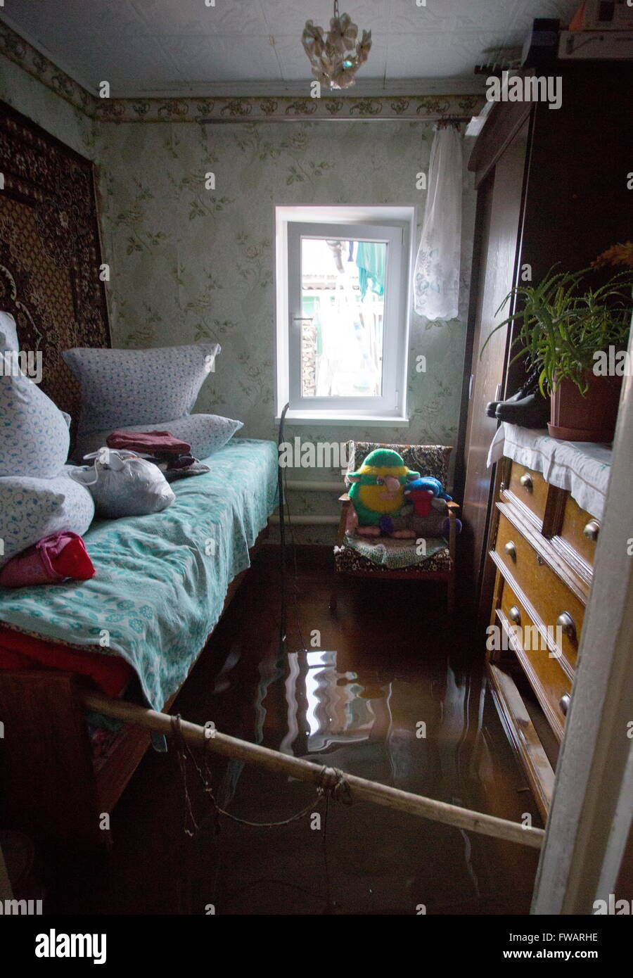 Omsk, Russia. 2nd Apr, 2016. A waterlogged private house. © Dmitry Feoktistov/TASS/Alamy Live News Stock Photo