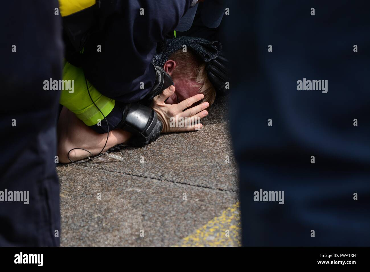 Dover, UK. 2nd April 2016. Clashes As Pro and Anti-refugee groups clash in Dover.  Protester lays on the ground - Stock Image