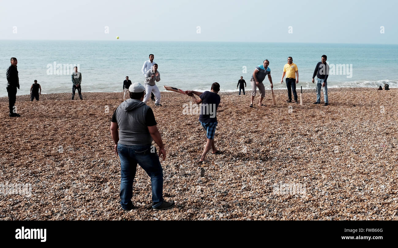 Brighton, UK. 3rd April, 2016. On the same day as the T20 Cricket World Cup Final is held  in India a group enjoy - Stock Image