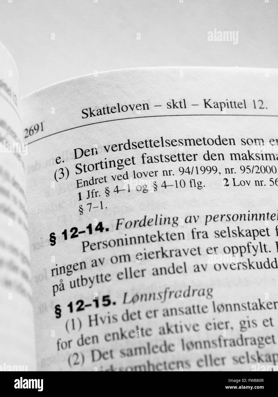 Page from the Norwegian law book, taxation laws 'Skatteloven', a foundation for a social democratic society - Stock Image