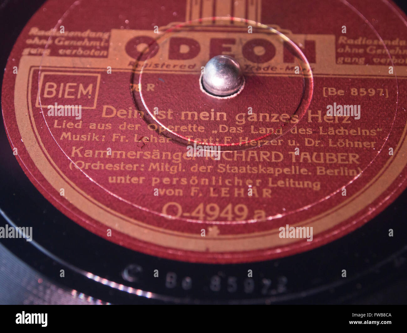 Closeup of antique record label, Richard Tauber sings ' Dein ist mein ganzes Hertz' by Lehar on Odeon record - Stock Image