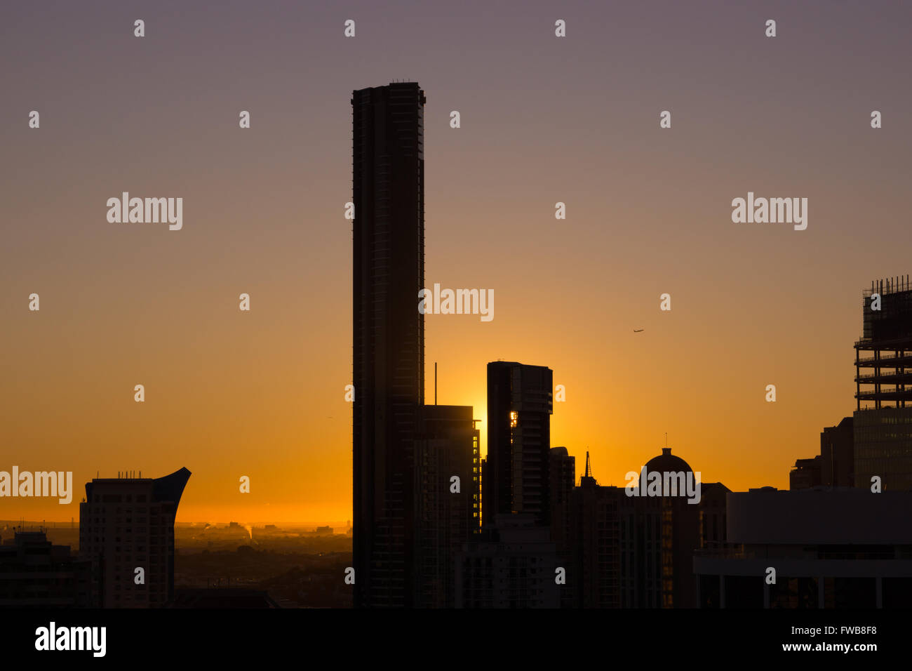 Brisbane skyline at dawn, buildings in silhouette - Stock Image
