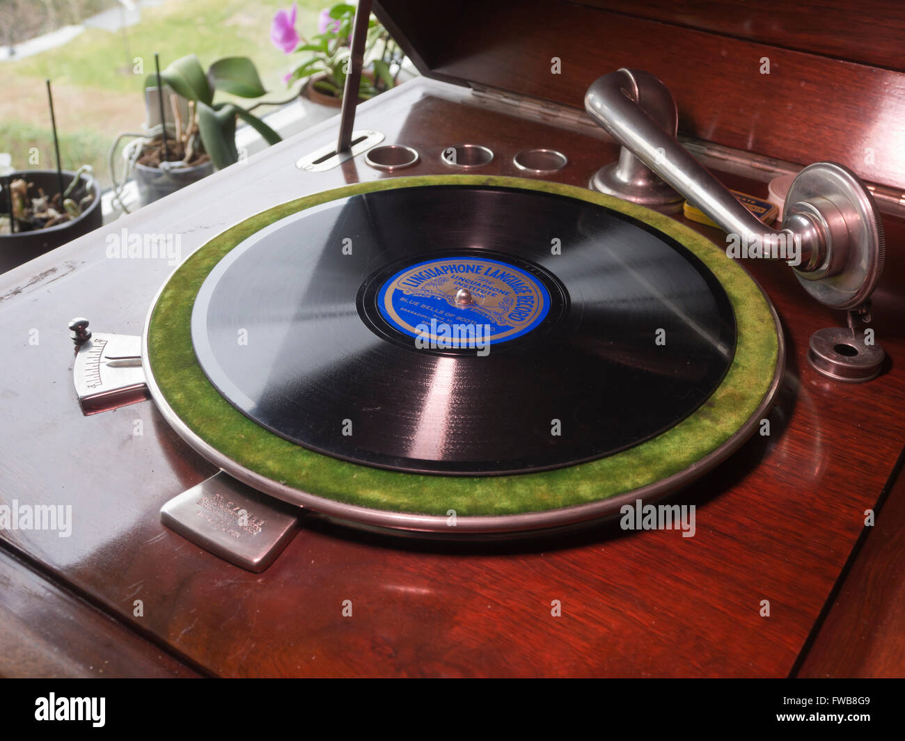 Linguaphone record language course, English songs, old shellac record on vintage wind up gramophone - Stock Image