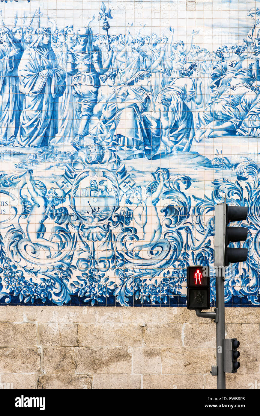 Traditional azulejos hand-painted tiles covering the exterior wall of the Igreja dos Carmelitas church in Porto, - Stock Image