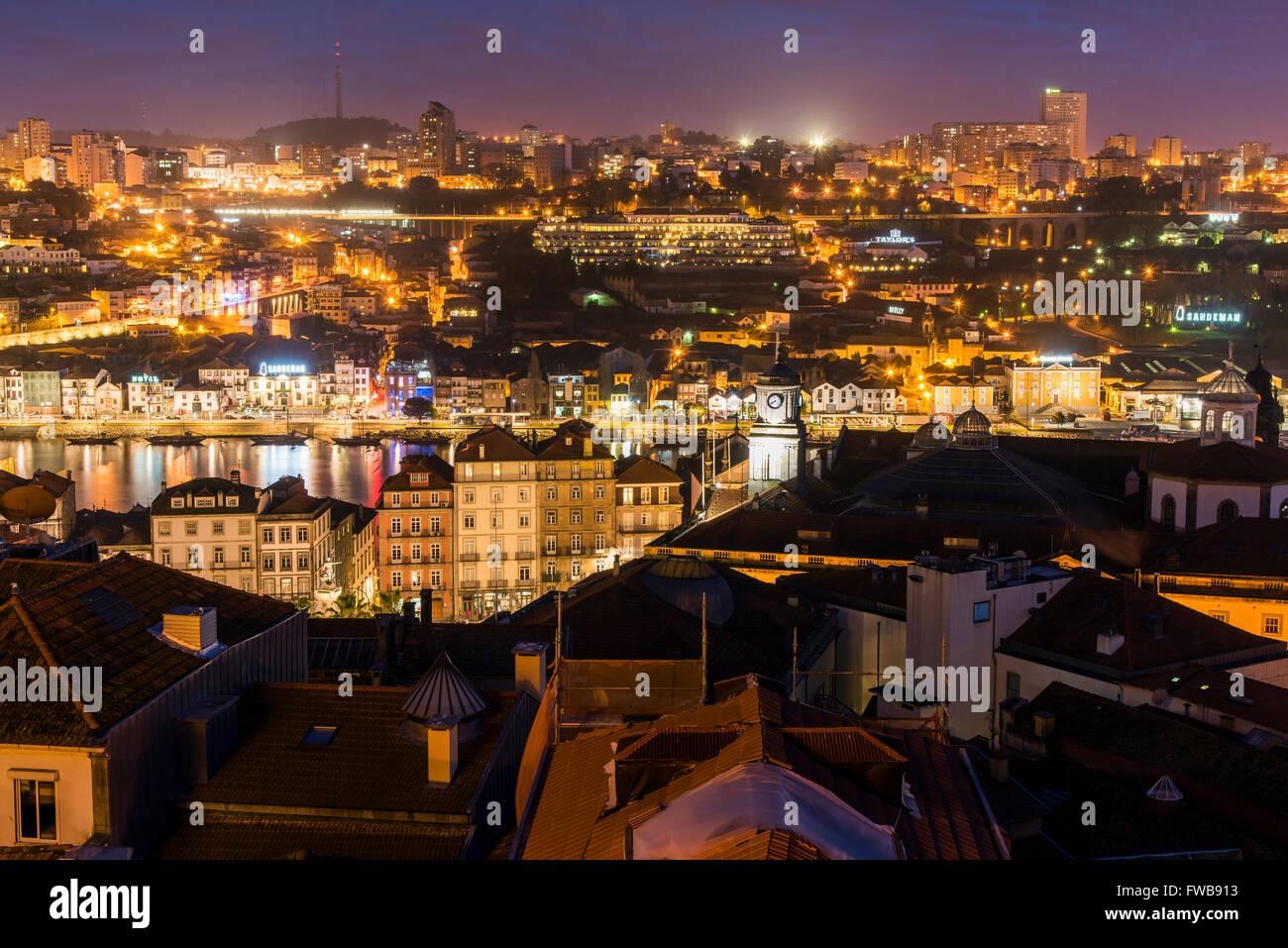 Night city skyline with Douro river and Vila Nova de Gaia district, Porto, Portugal - Stock Image