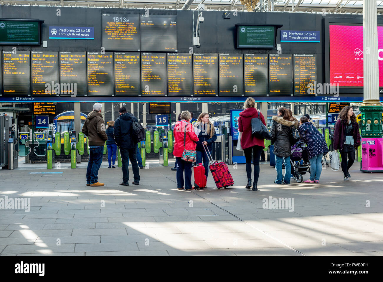Commuters at Edinburgh Waverley railway station in Scotland - Stock Image