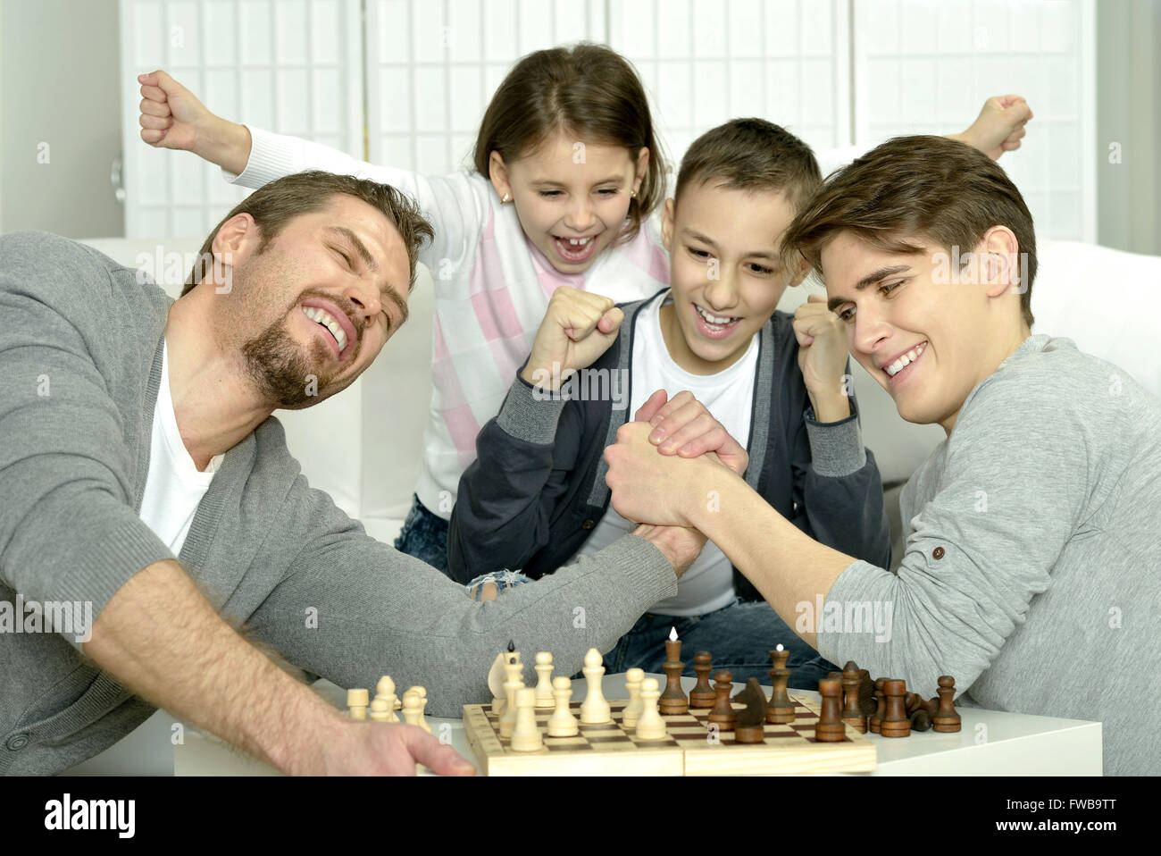 family playing chess at home stock photo 101667464 alamy rh alamy com chase at home log in cheese at home