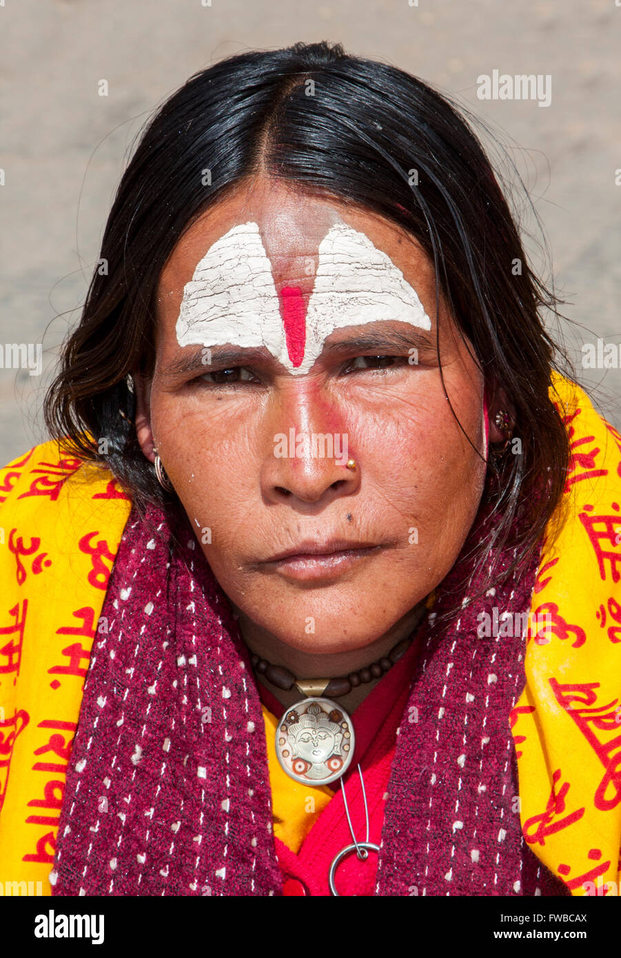 Nepal, Pashupatinath.  Female Hindu Sadhu (Ascetic).  She wears a nose pin in her nostril. - Stock Image