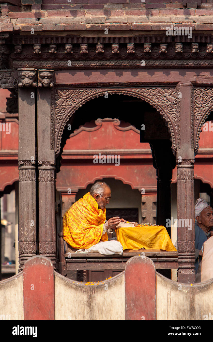 Pashupatinath, Nepal.  Sadhu, a Hindu Ascetic or Holy Man, Reading Sacred Texts in the Temple. Stock Photo