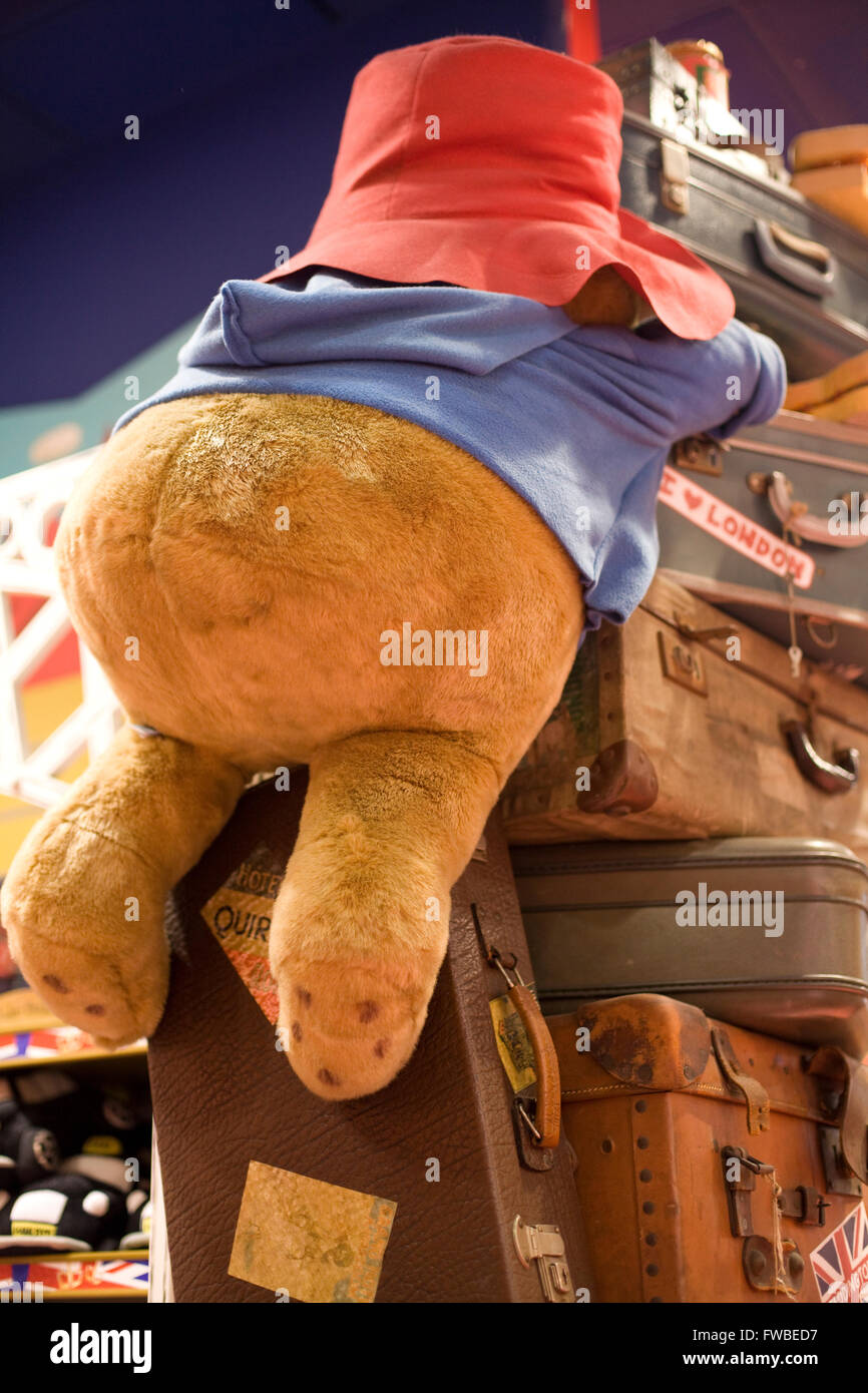 Paddington Bear soft toy climbing on suitcases Stock Photo