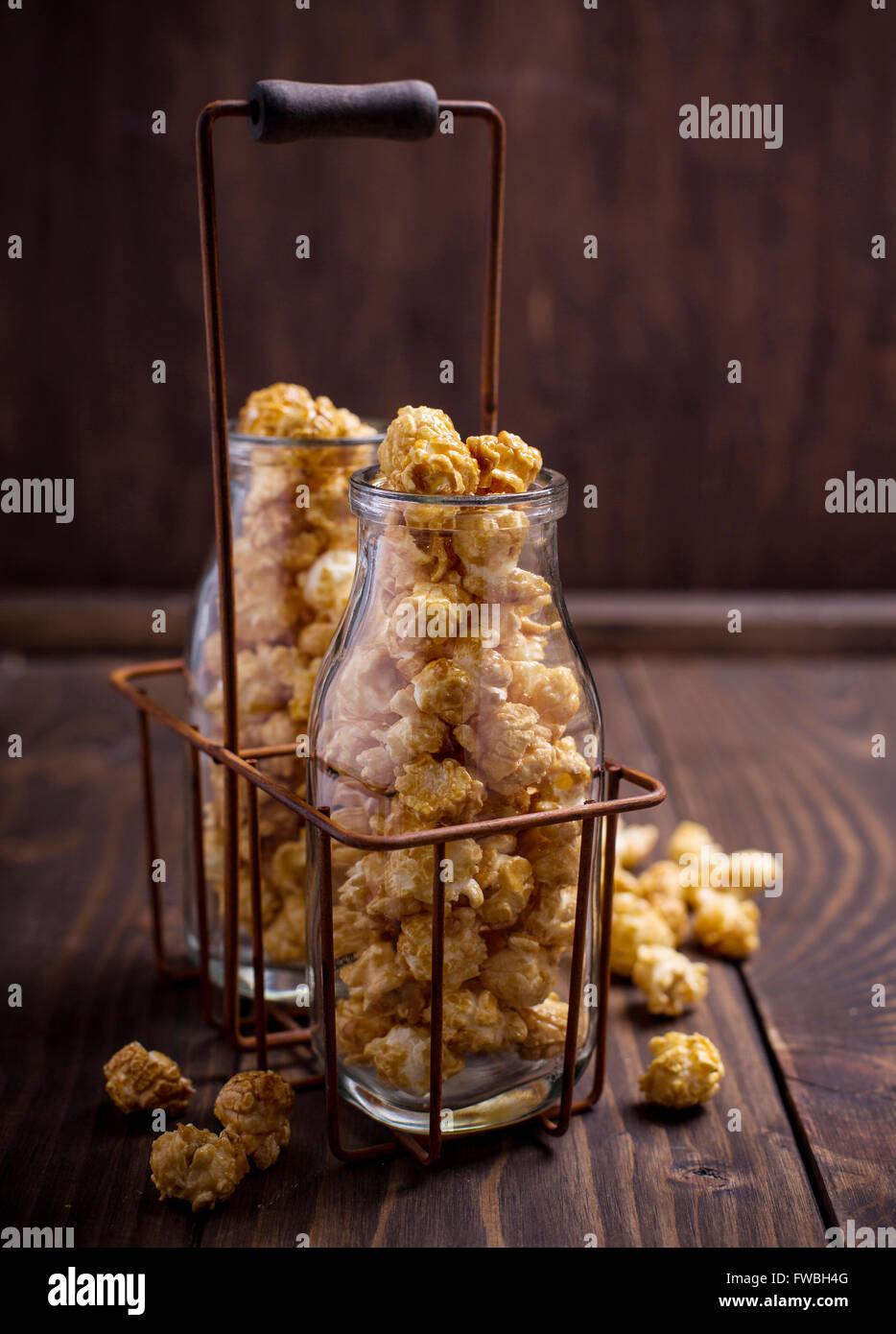 Close up of glass bottles full of sweet popcorn - Stock Image