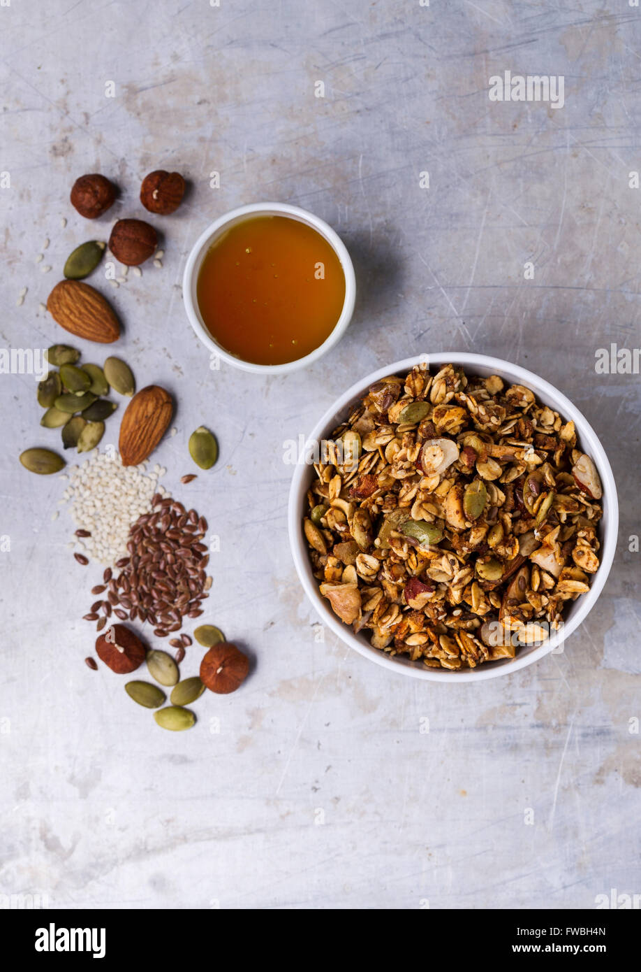 Homemade granola with honey shot from above - Stock Image