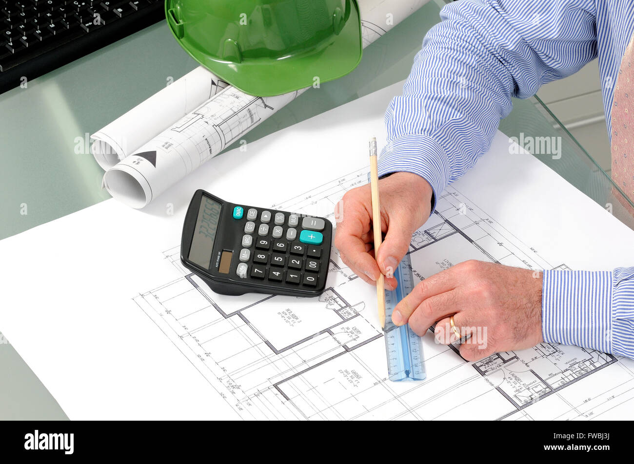 Engineer at work in the office on a residential construction project. - Stock Image