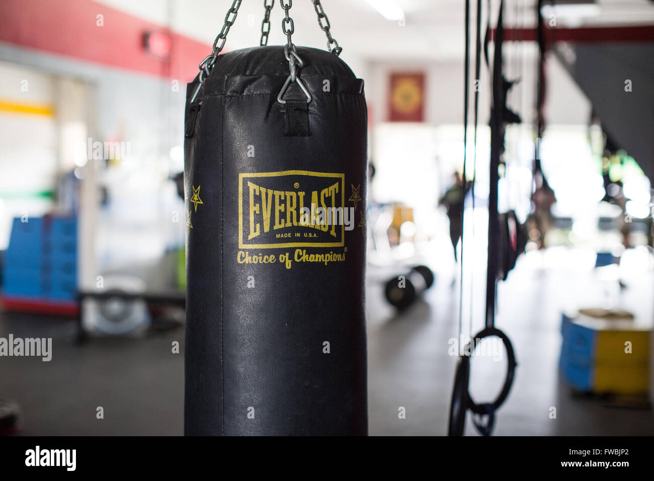 An Everlast boxing bag hanging inside a CrossFit box in California. - Stock Image