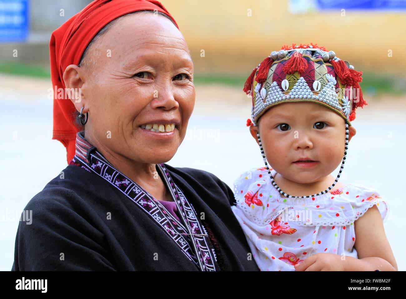 Portrait of smiling Red Dao woman and child, Sapa Surroundings, Vietnam, Asia Stock Photo