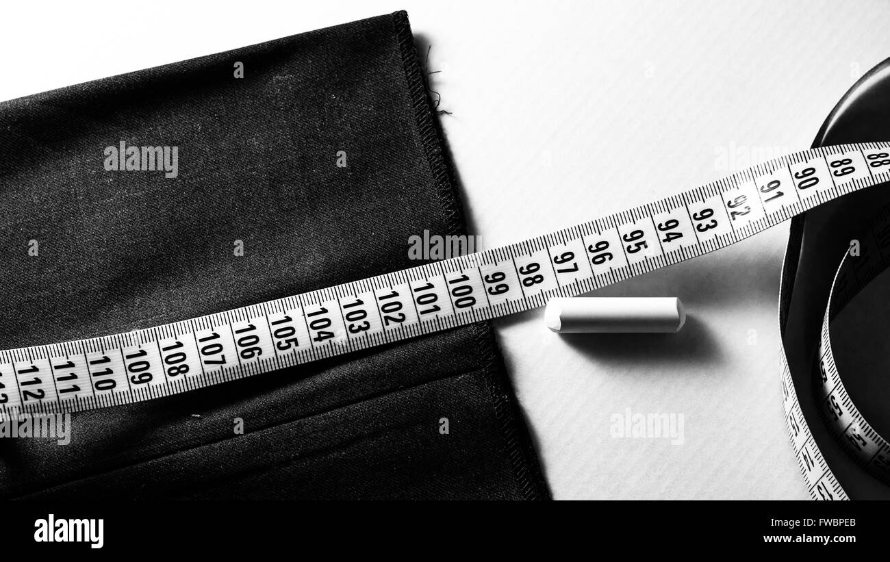 still life with a tape measure a chalk and tissue - Stock Image