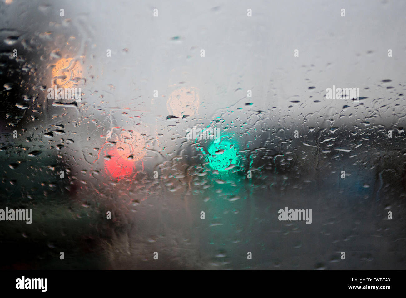 Beads of rain on a window pane - Stock Image