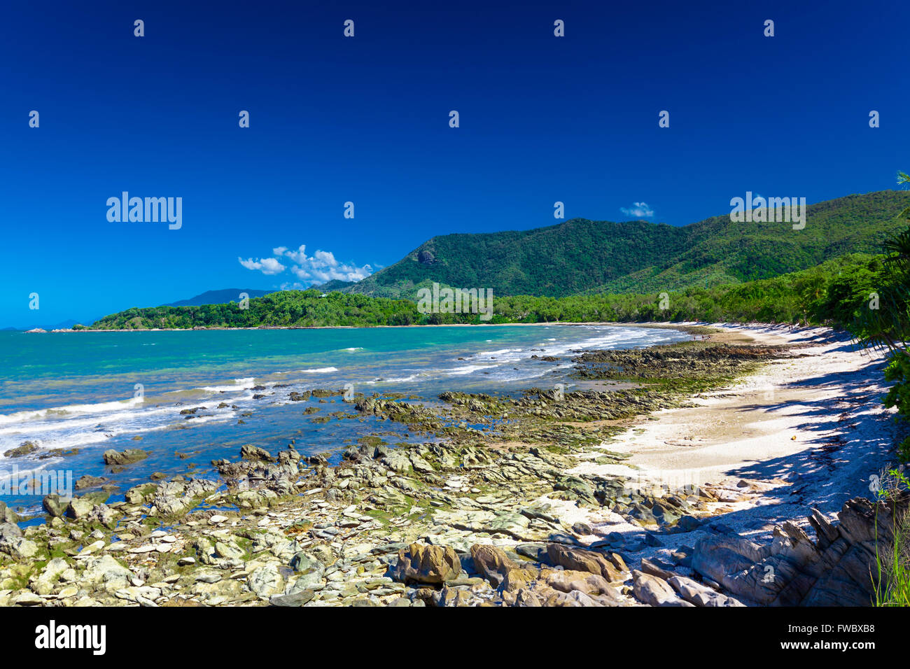 Ellis Beach with rocks near Palm Cove and Cairns, Australia - Stock Image