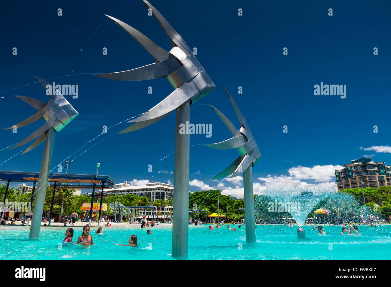 CAIRNS, AUSTRALIA - 18 OCT 2009 - People enjoy a hot day, lagoon at Cairns Esplanade. The Cairns Esplanade has a - Stock Image
