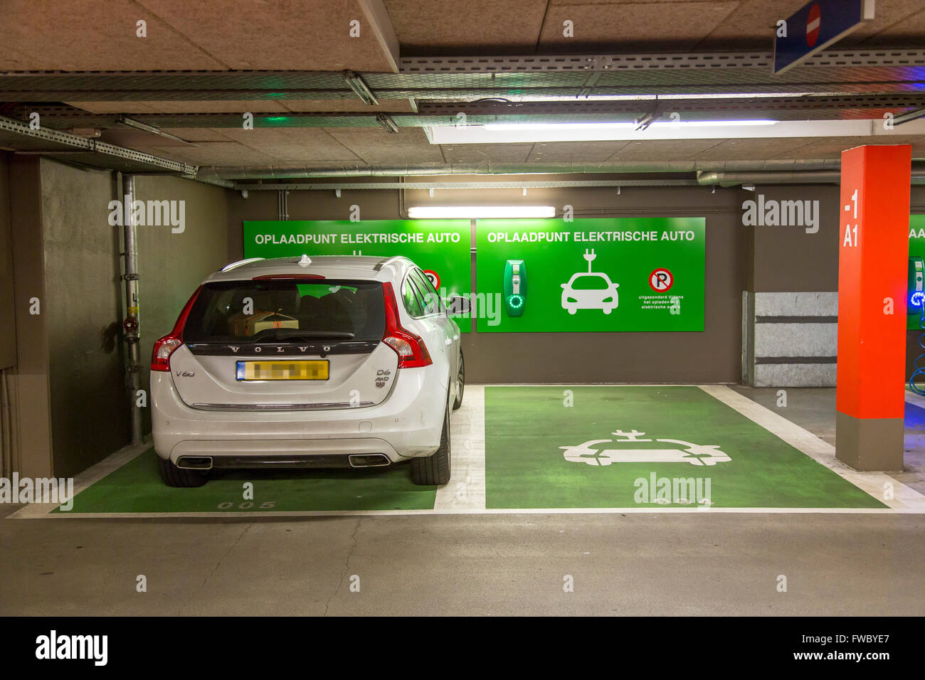 charging station for electric cars in a public parking. Black Bedroom Furniture Sets. Home Design Ideas