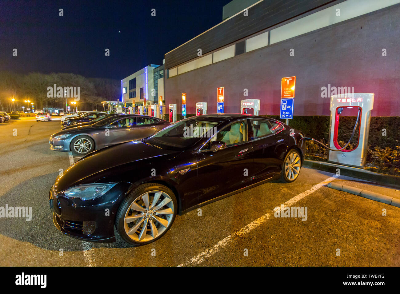 Tesla Motors, electric car charging station, in Eindhoven, The Netherlands, Tesla Superchargers, mobility, technology, - Stock Image