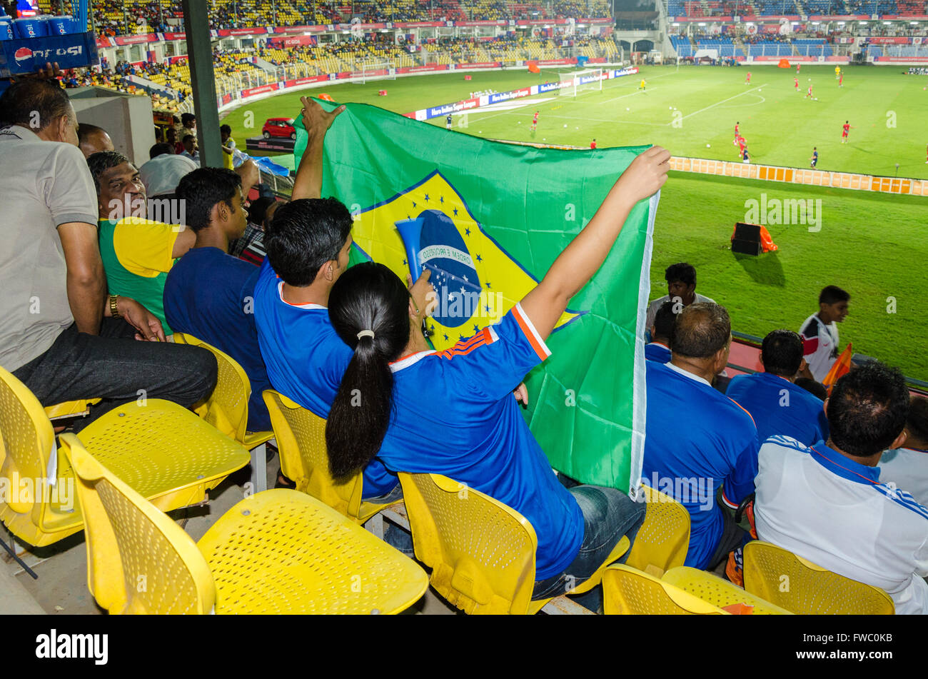 FC Goa supporters display Brazil Flag during Indian Super League (ISL) round two encounter against Atlético - Stock Image