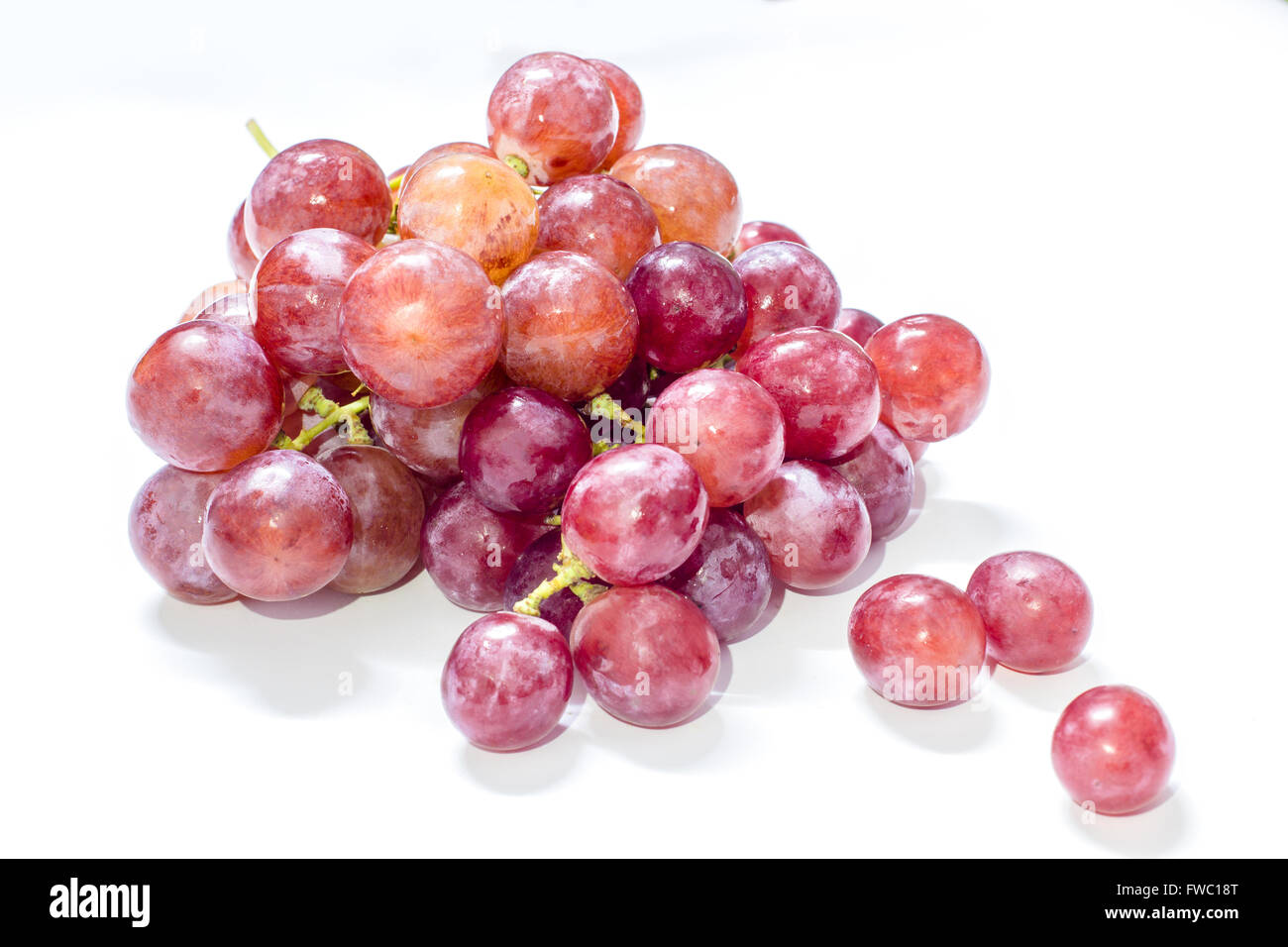 A bunch of fresh red grapes - Stock Image