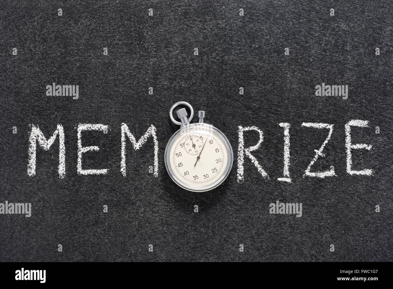 memorize word handwritten on chalkboard with vintage precise stopwatch used instead of O - Stock Image