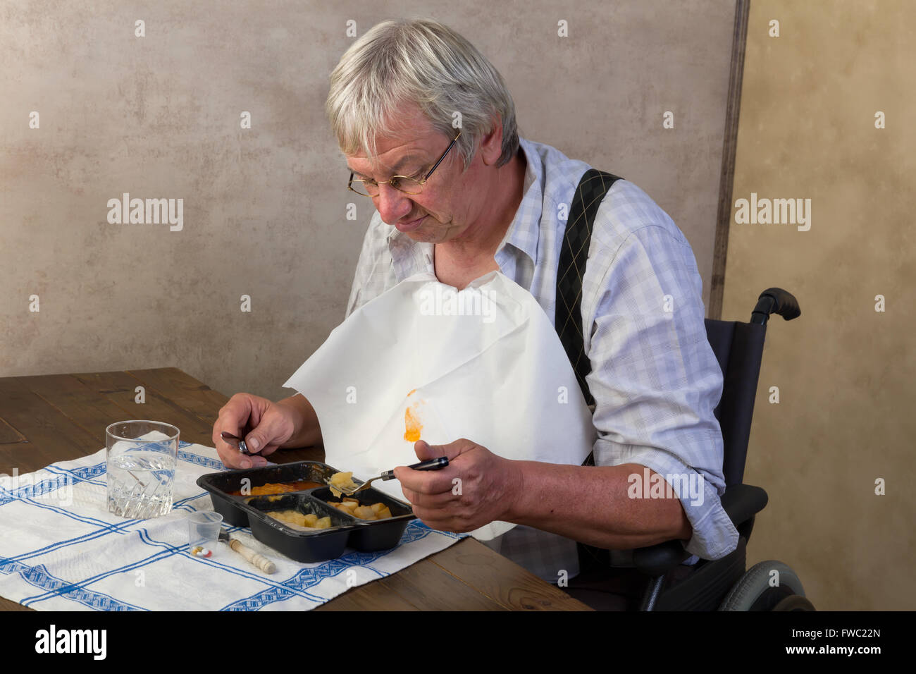 Elderly man in nursing home disliking his ready made dinner - Stock Image