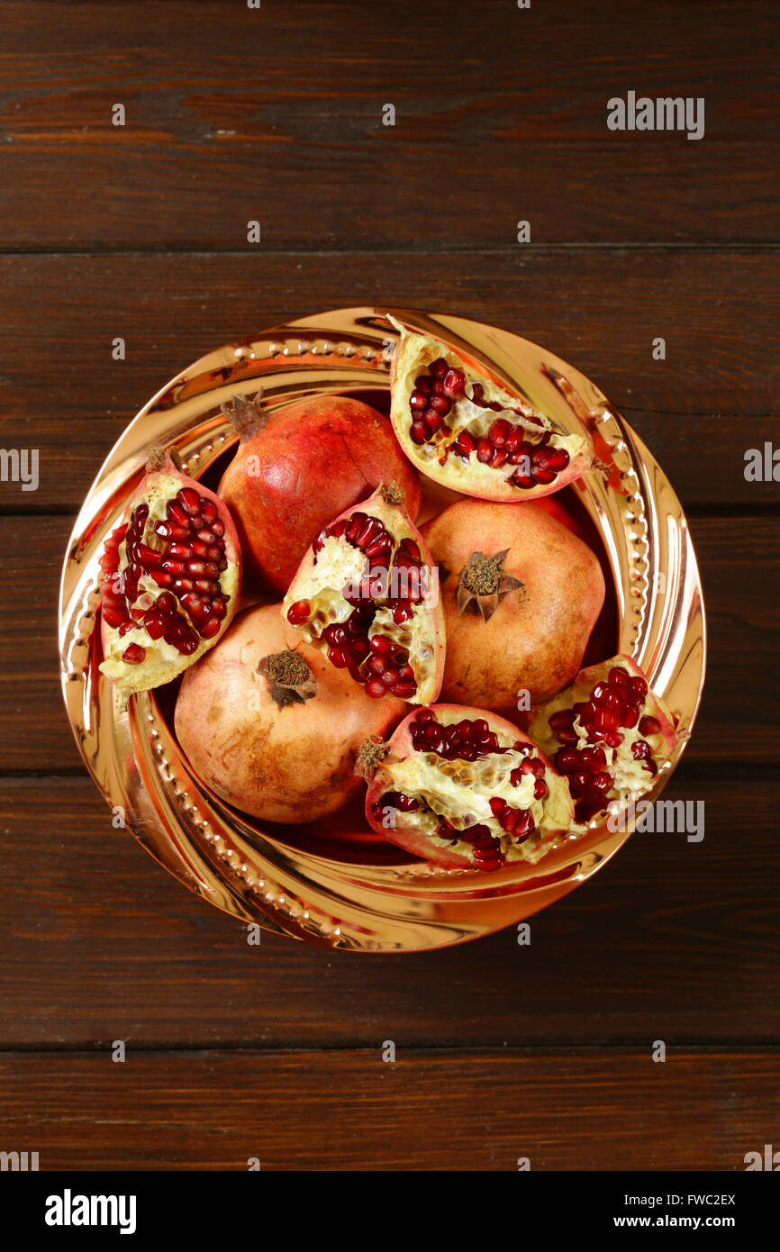 Organic ripe red fruit pomegranate, whole and broken Stock Photo