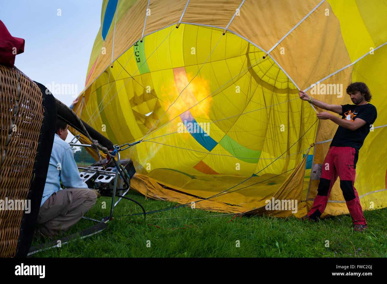 Heating up aerostat (baloon) with hot air, Spain - Stock Image