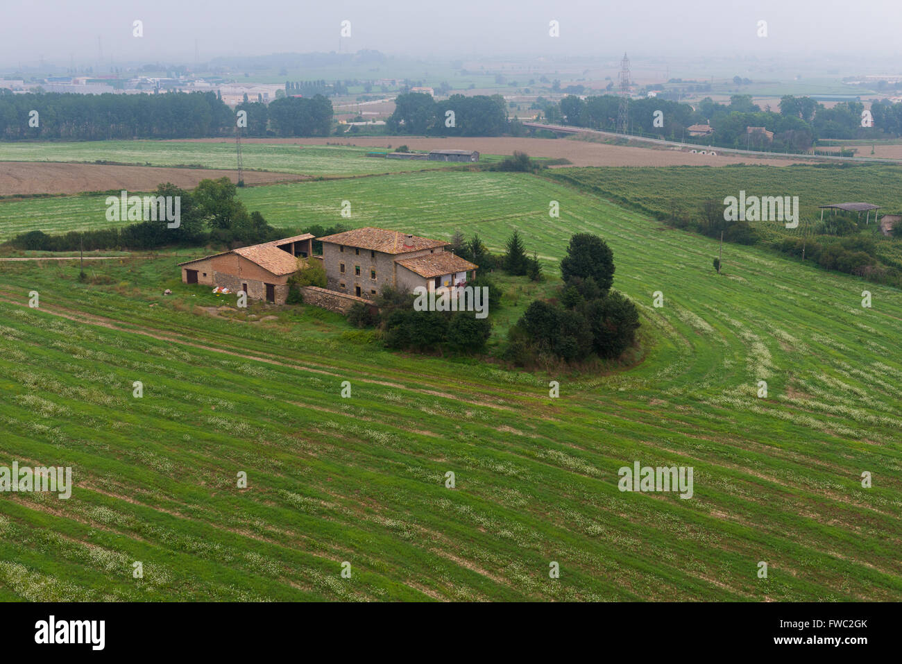 Small farm house among fields from air balloon near Vic, Spain - Stock Image