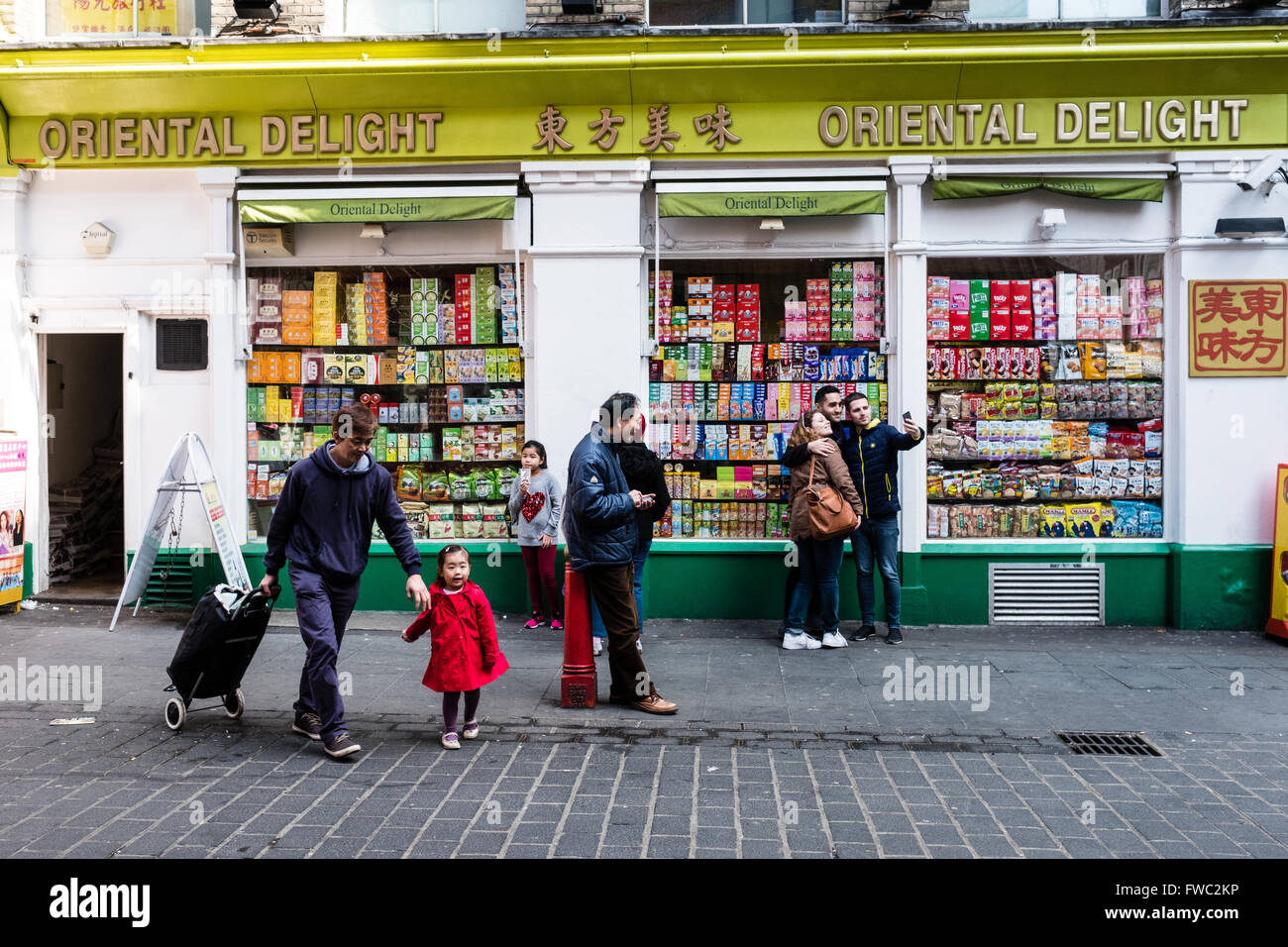 People outside a shop in China Town, London Stock Photo