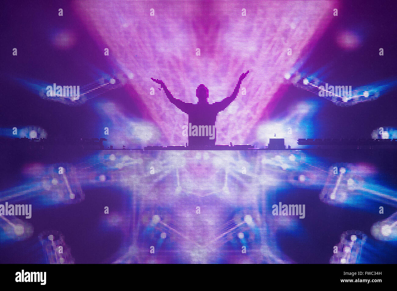 DJ Calvin Harris performing live on the decks at the T in the Park festival in Scotland. - Stock Image