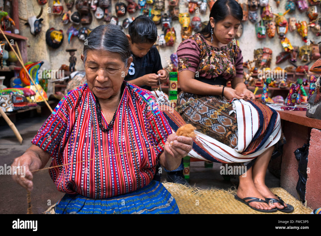 Nim Po't, souvenir shop in Antigua, Guatemala. Mayan women weave inside the store. Nimpot is a handicraft shop located in the he Stock Photo