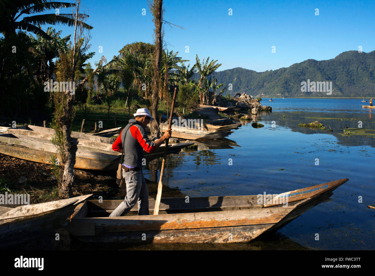 Men fishing in the traditional manner in Lake Atitlan the largest lake of Guatemala - Stock Image
