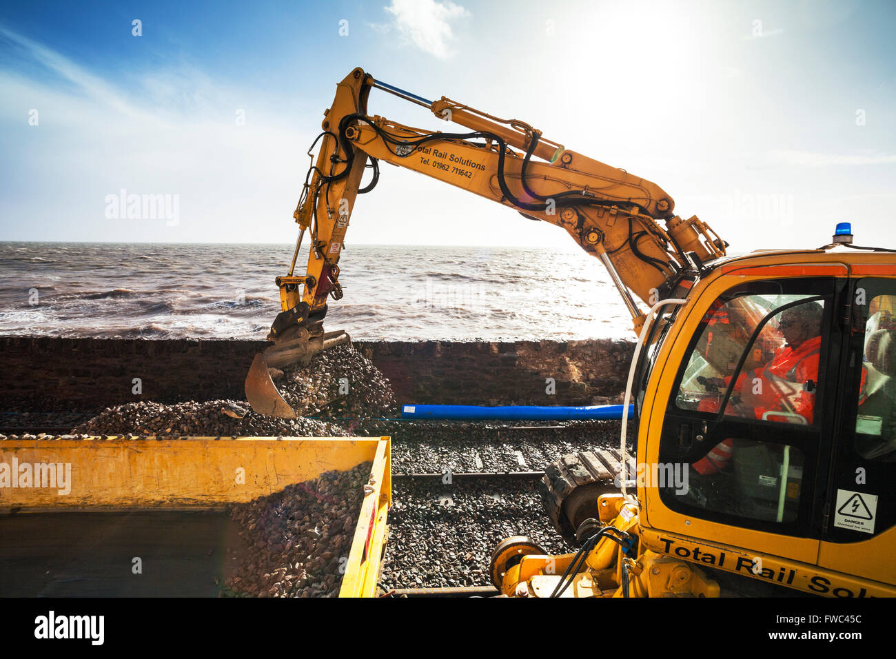 08/02/14 Network Rail Dawlish - repair works continue despite high tides and stormy weather - Stock Image