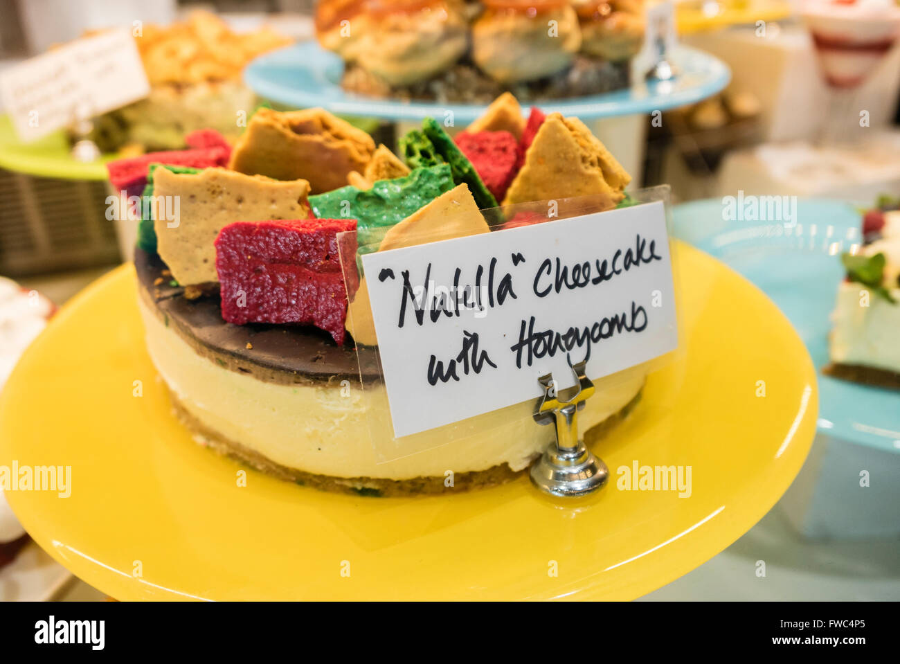 Nutella cheesecake with honeycomb dessert on display in a restaurant - Stock Image