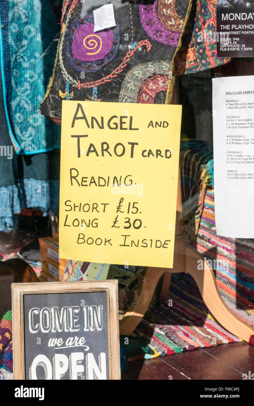 Sign advertising Angel and Tarot card readings in the window of a