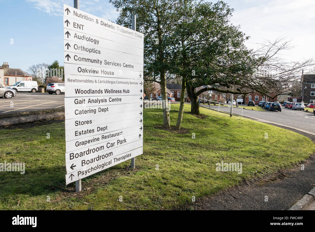 Sign at a hospital giving directions to various wards, services, departments and restaurants. - Stock Image