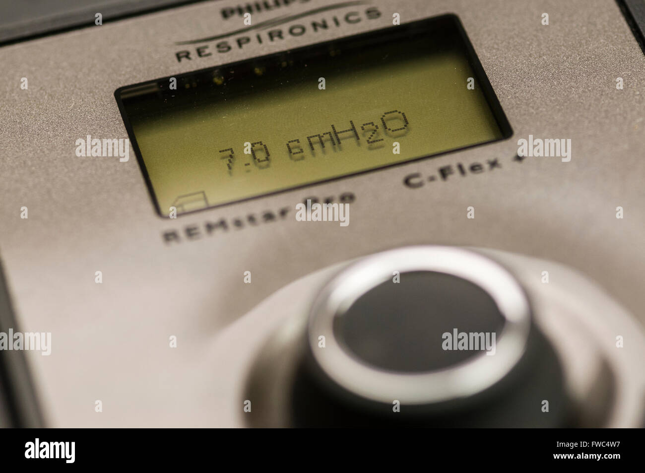 Philips Respironics System One CPAP machine set to an air pressure of 7.0 cm H2O (LED backlight not illuminted) - Stock Image